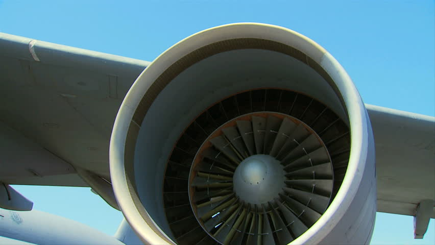 Large jet engine turbine blades slowly turning