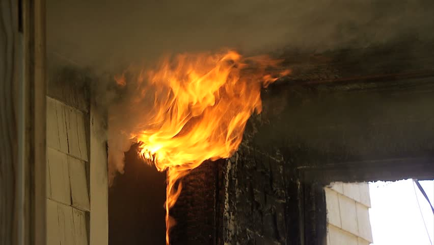 Flames coming out window of house on fire