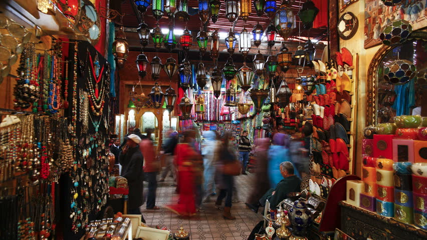 MARRAKESH, MOROCCO - CIRCA MAY 2011: Interior shot of the Souq as various people are shopping