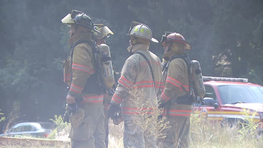 EAST GREENWICH, RHODE ISLAND - CIRCA AUGUST 2010: Firemen discussing strategy at house fire