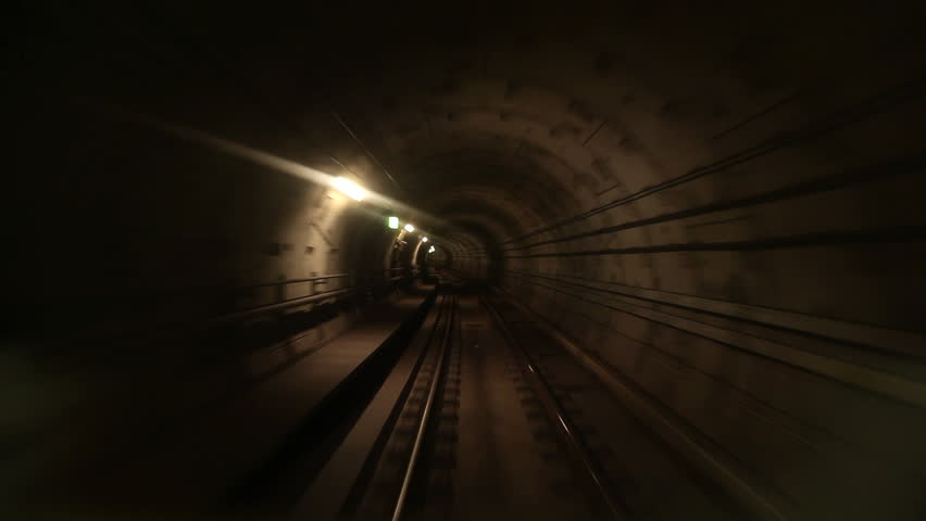 View of a subway tunnel as seen from the front of a moving train