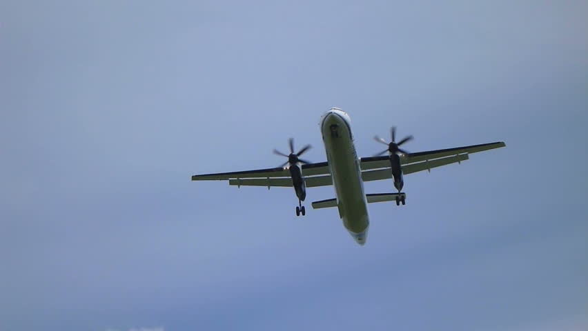 Commercial passenger airplane flying overhead on sunny day. - HD stock footage clip