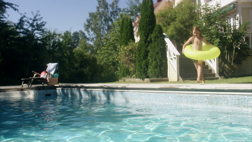 Couple Relaxing On Poolside Stock Footage Video 2629235
