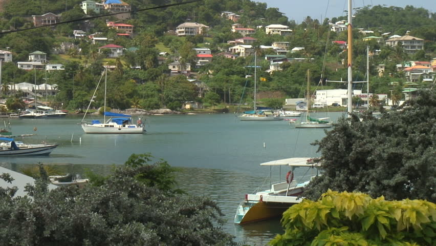 ST. GEORGE'S - AUGUST 9:  Small boats at anchor in the capitol city of Grenada August 9, 2008. Reconstruction from Hurricane Ivan in 2004 is nearly complete. - HD stock footage clip