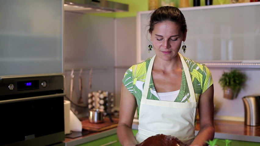 House wife presenting freshly baked chocolate cake