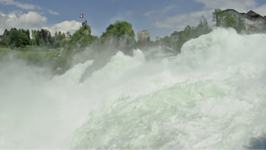 Water of Rhine Falls in Switzerland. Part of the famous waterfalls of the river Rhine (Rhein) in Schaffhausen (with sound)  - HD stock video clip