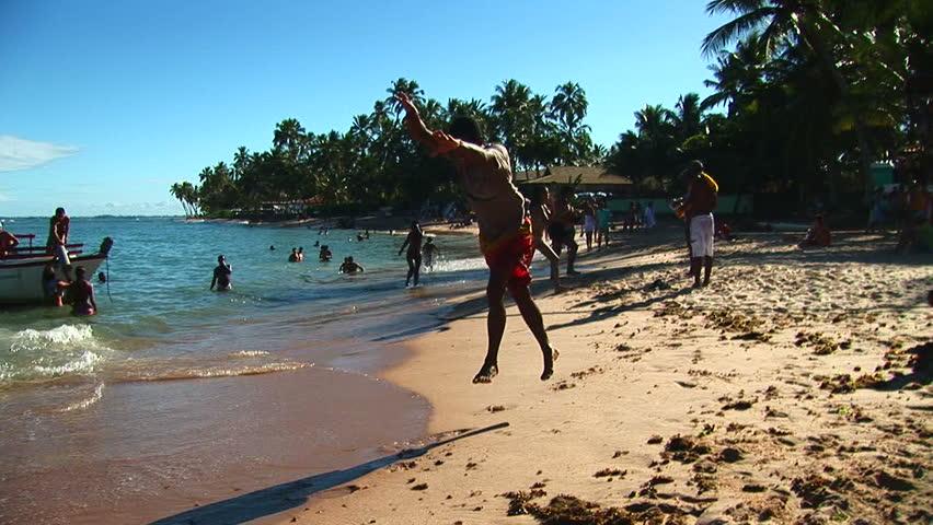 SALVADOR, BRAZIL - April 2008: Beach artist doing gymnastics in Salvador, Bahia, Brazil