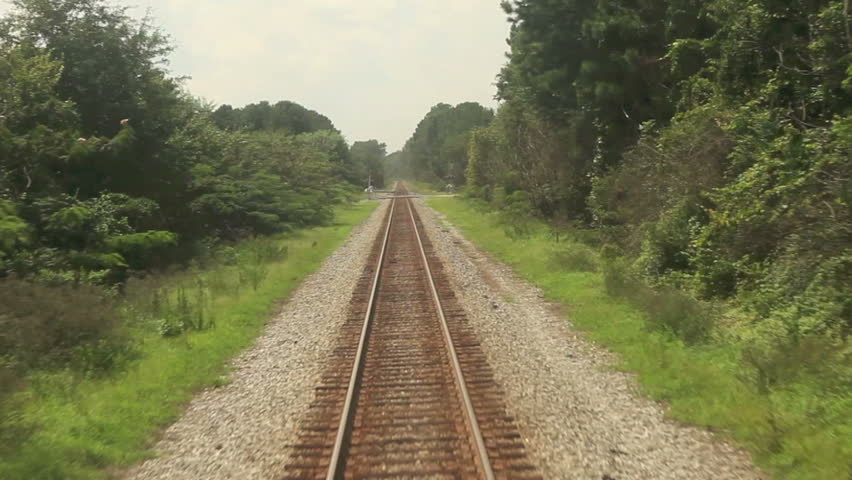 point of view footage of train moving along tracks - HD stock footage clip