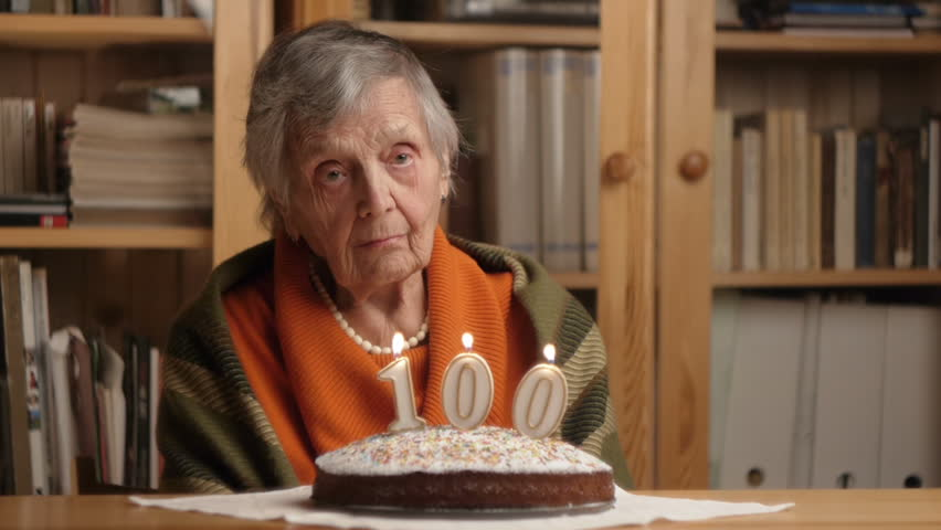 Happy Grandmother Blows 100 Candles On A Birthday Cake Stock Footage ...