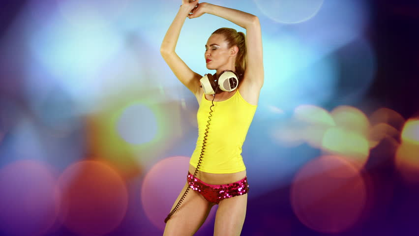 a sexy gogo dancer shot in a studio dancing agaisnt green screen with disco style background added - HD stock footage clip
