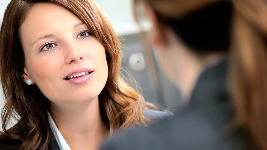 Female banking executive greeting young businesswoman to discuss future financial plans
