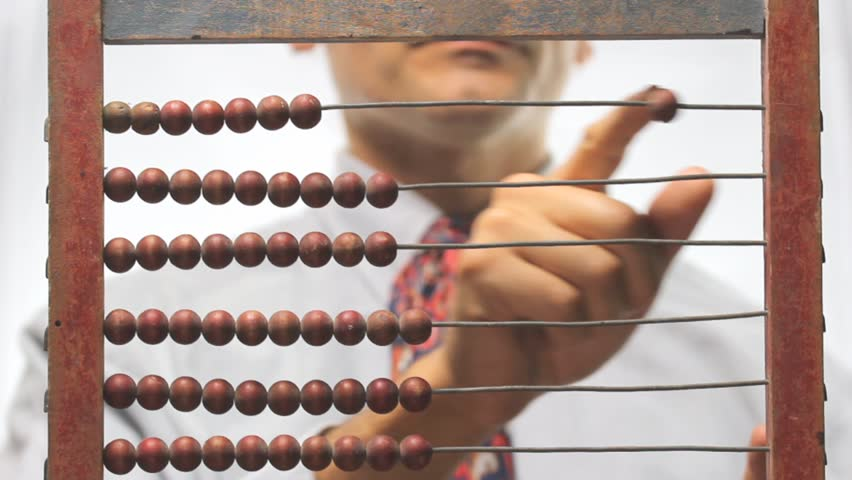 out of focus man and old abacus - HD stock footage clip