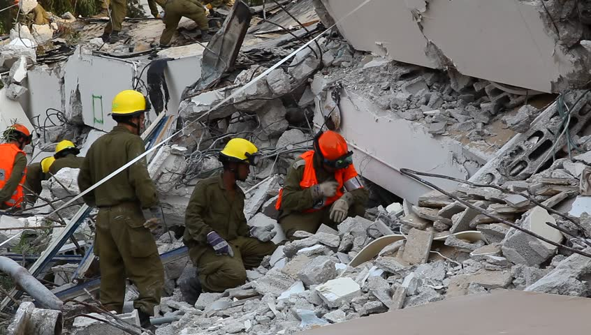 HOLON, ISRAEL - OCTOBER 21: Soldiers search for earthquake casualties digging through the rubble during earthquake drill in Holon, Israel, October 21, 2012