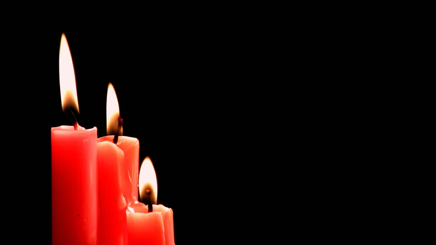Seamless loop three red candles burning on black background HD