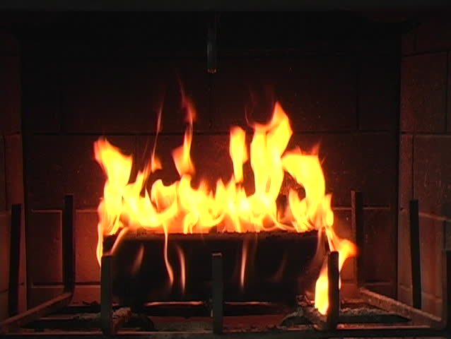 Flame in a fireplace with a dark background