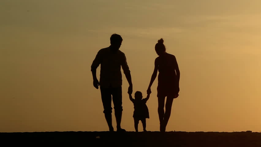 Silhouette of family walking together at sunset - HD stock video clip
