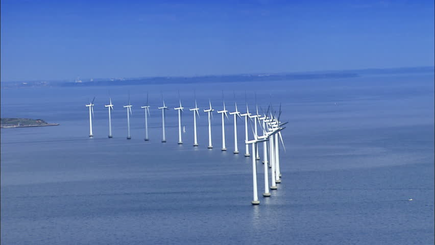 Aerial view of wind turbines at sea - HD stock video clip
