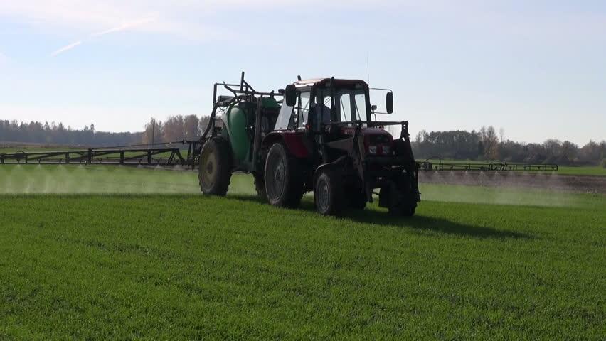 farm tractor spray autumn season green crop field