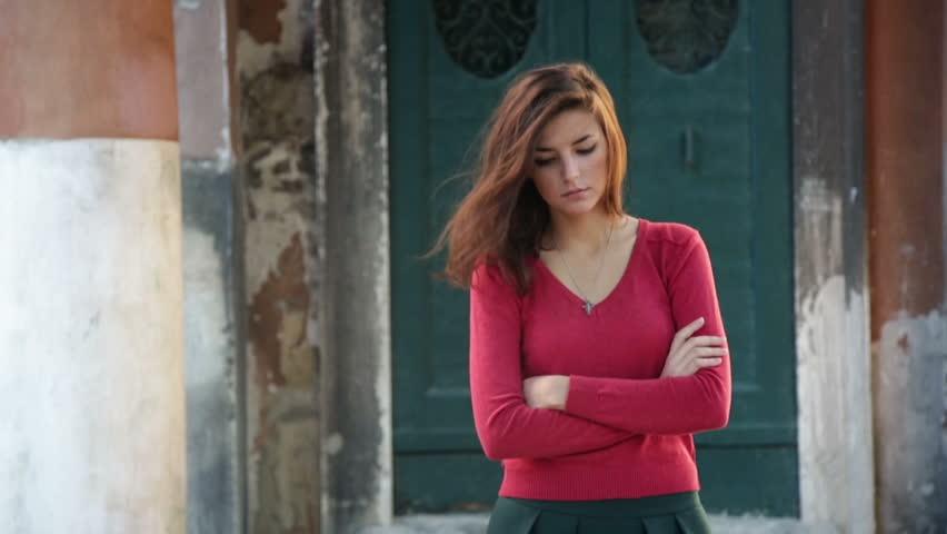 Young girl walks through the narrow streets of Venice