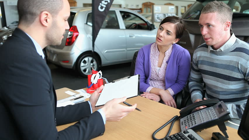 Client signing a contract in a dealership
