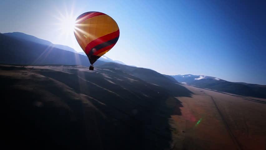 hot air balloon in mountain landscape