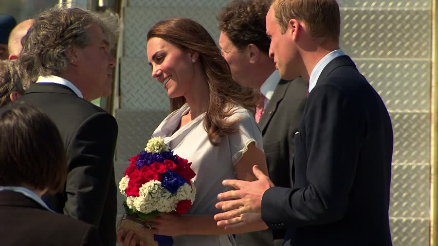Los Angeles, CA - JULY 08, 2011:  Prince William and Kate Middleton Arrive at LAX airport and walk off a plane and receive flowers
