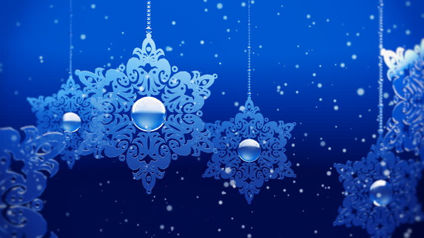 Christmas decorations with particles of snow on blue background.