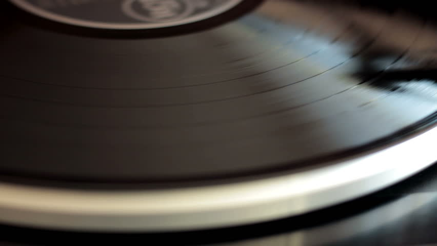 Vinyl rotating on a turntable, close up