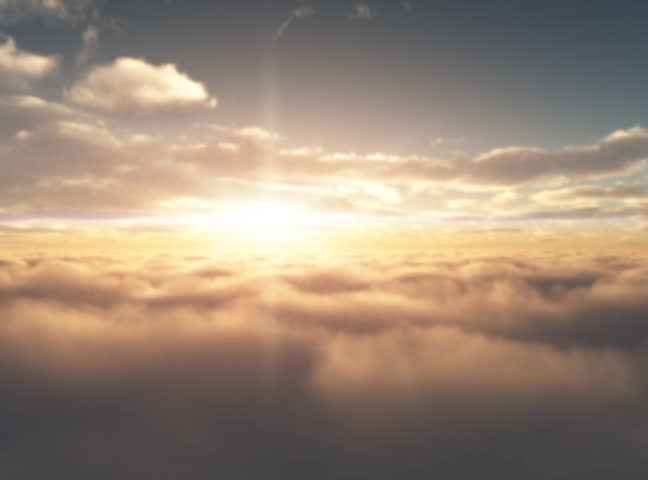 Aerial Sunrise.  Sunrise as seen from the air between two different cloud layers.  Sun in front of camera. - SD stock video clip