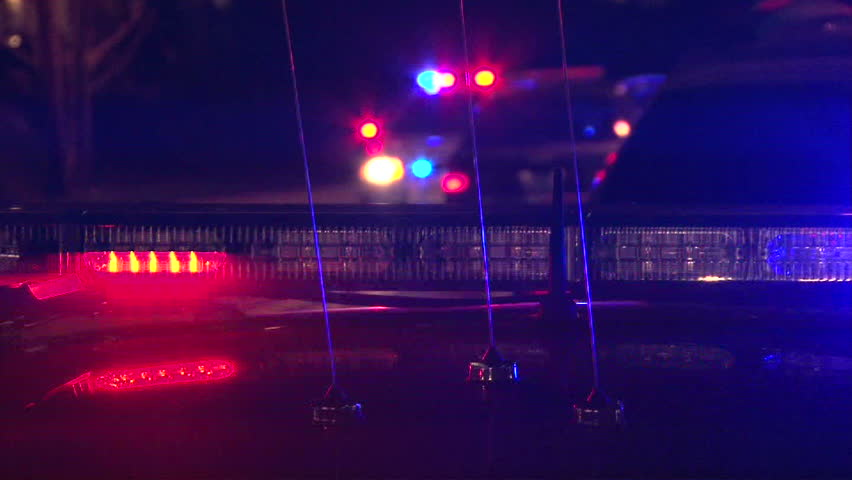 Police lights flashing at night downtown at crime scene. - HD stock footage clip
