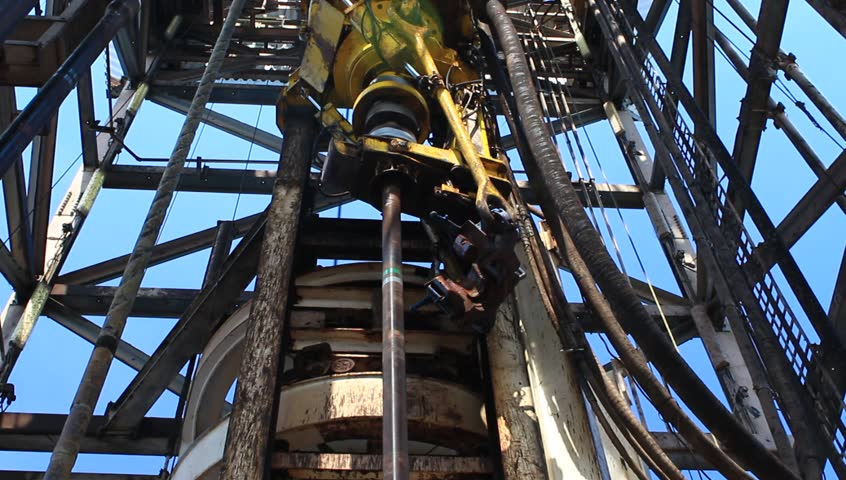Top Drive System (TDS) Spinning for Oil Drilling Rig - Oilfield Industry  - HD stock footage clip