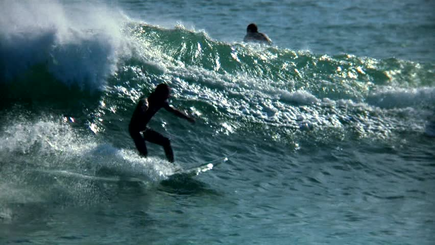 Slow-motion surfer beautifully backlit. - HD stock footage clip