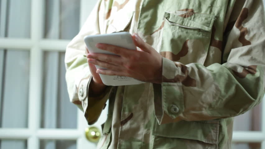 Soldier using a touch pad device - HD stock video clip