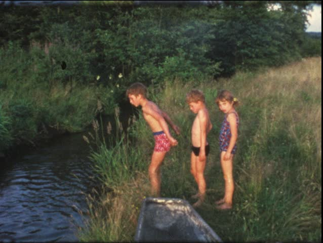 Vintage 8mm film: Children in bathtub on pond, 1960s
