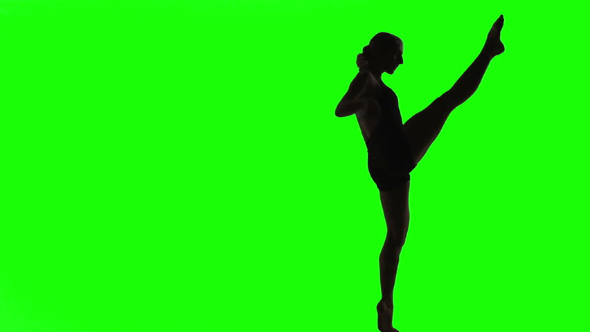 Silhouette of young woman doing a modern dance piece in front of green screen