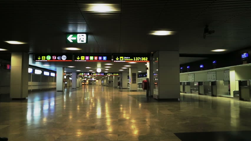 Hallway of airport with illuminated information signboards on the ceiling - HD stock video clip