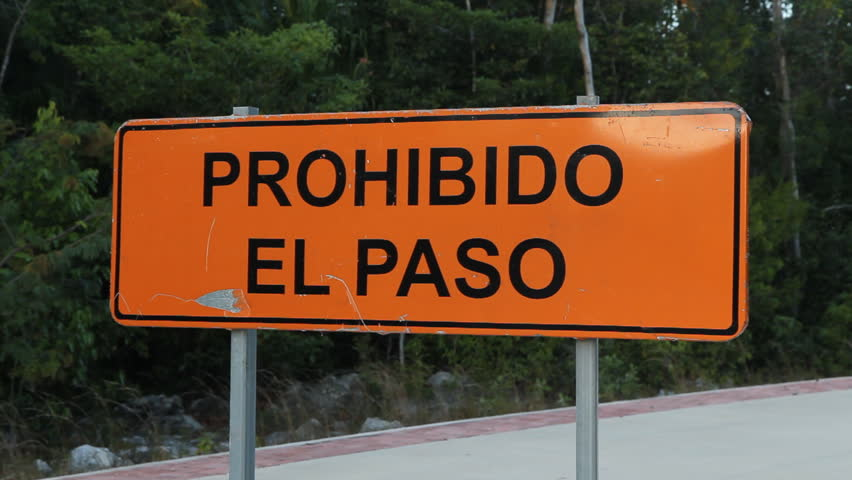Road sign that says prohibido el paso or prohibited to - Prohibido el paso ...