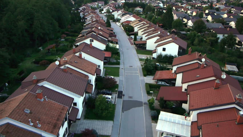 AERIAL: Flight over suburban houses