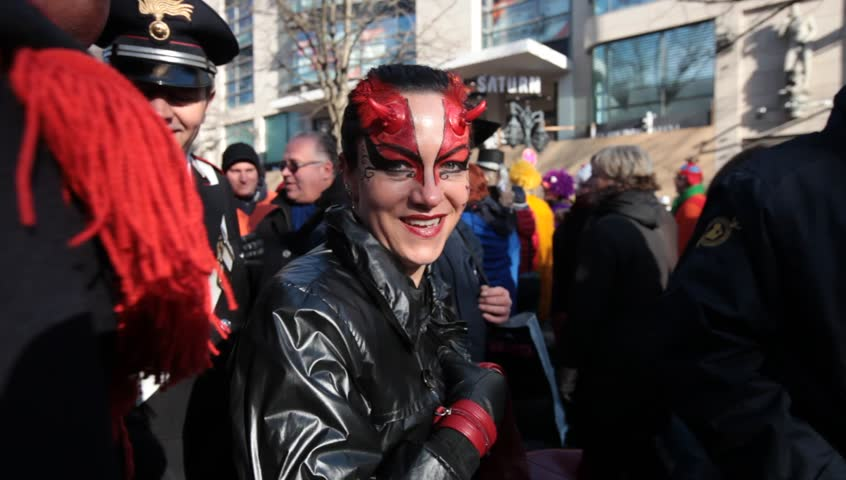 DUSSELDORF, GERMANY – FEBRUARY 10: People present their costumes for the next day celebration of Rosenmontag Karneval or Carnival. February 10, 2013,  Düsseldorf, Germany  - HD stock video clip