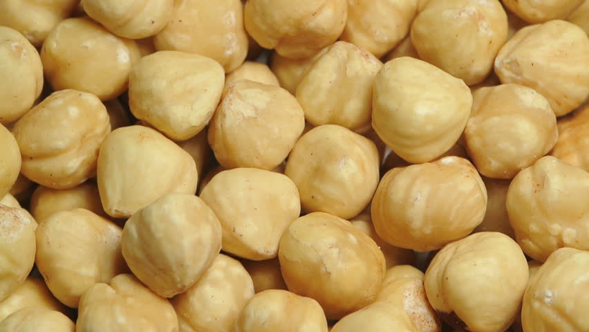 A pile of shelled hazelnuts rotating slowly
