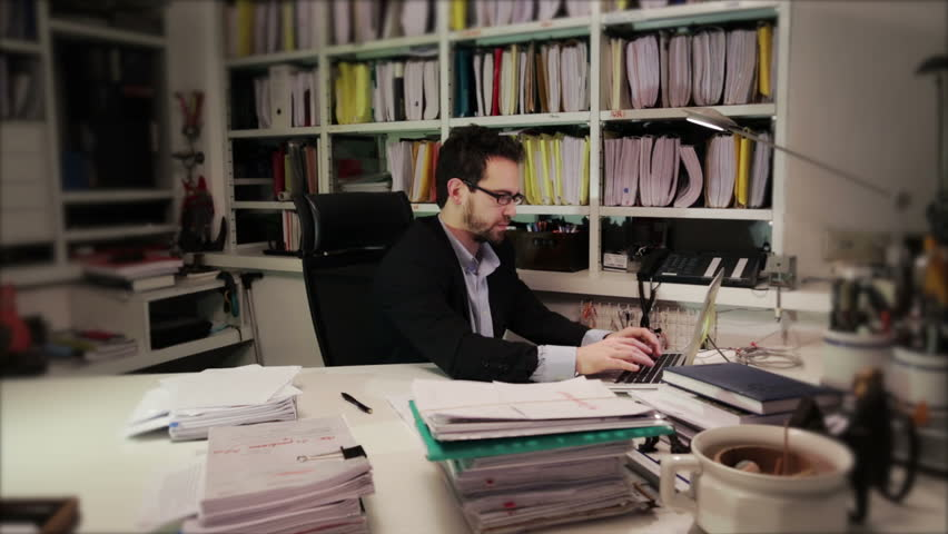 Businessman choosing folder from the archive of his office