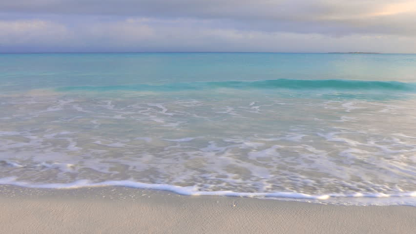 Tropical Waves Gently Breaking Onto A Sandy Caribbean Beach In Varadero, Cuba
