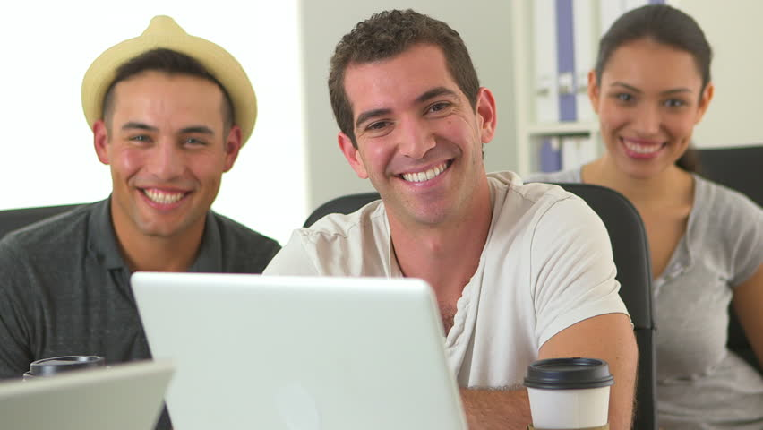 Close Up Of Diverse Group Of Office Workers At Laptop ...  Close Up Of Div...