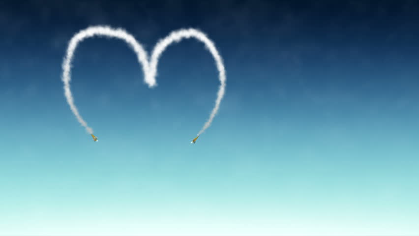 Two Planes Drawing a heart in the sky with smoke.