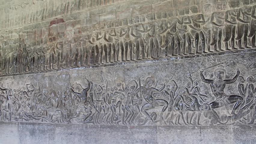 Wide shot pan across angkor wat bas relief depicting war for Bas relief mural