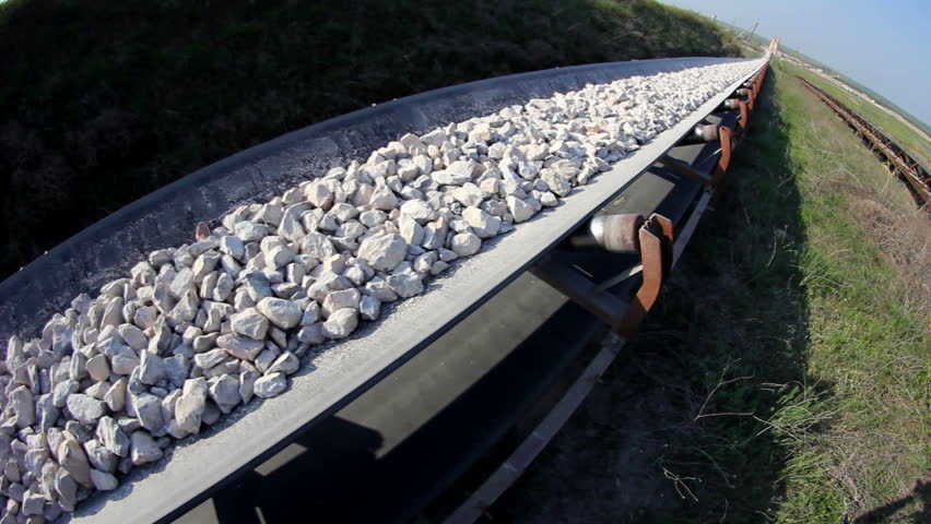 Fisheye of a long conveyor belt transporting stones to the manufacturing plant about 5 miles away.