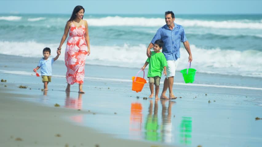 Summer beach walk of loving Hispanic family shot on RED EPIC - HD stock video clip