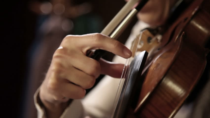 Close up pan shot of a violin player - HD stock footage clip