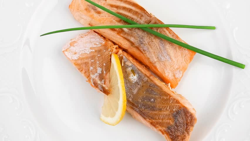 savory sea fish entree : roasted salmon fillet with green onion and lemon plate 1920x1080 intro motion slow hidef hd