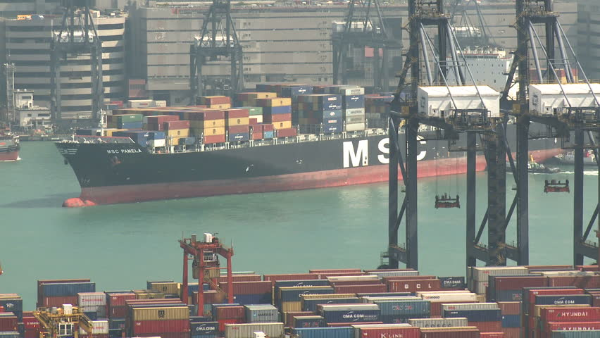 HONG KONG, CHINA - AUGUST 2012: Container Ship Arrives At Port. Shot overlooking Hong Kong container terminal in full HD on Sony EX1. - HD stock footage clip